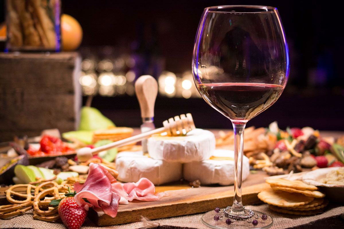 Wine, meat, and cheese plate A Romantic Dinner at Home: Your Menu Planning Guide