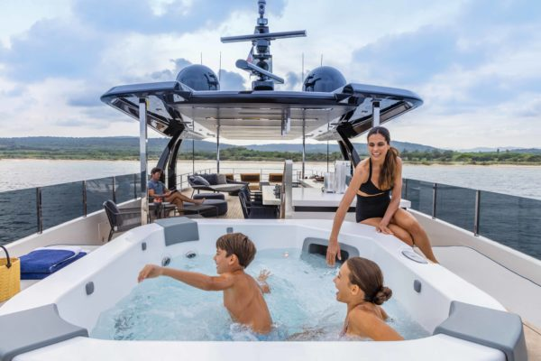 The sun deck features an outdoor jacuzzi and a covered socialsing area