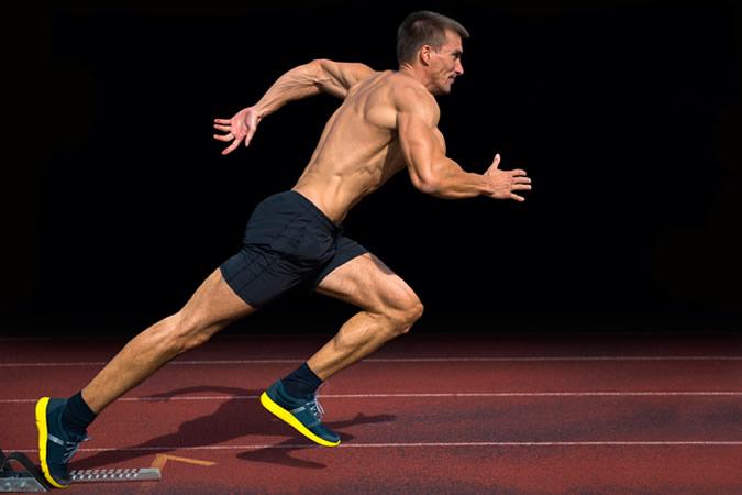 Athlete Practicing Start on 100m Sprint
