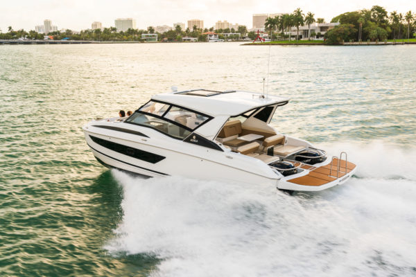 The Aquila 32 features a swim platform that wraps around the outboards