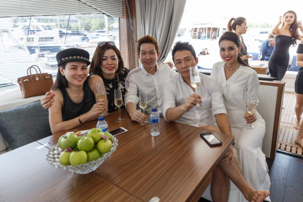 Guests enjoy the interior of a yacht that only had its world premiere at Cannes last September
